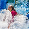 Mya Creel, 9, cools off by splashing in the water slide at the Interlachen Independence Day Celebration. The Rotary provided three different water slides for kids of all ages. Fran Ruchalski/Palatka Daily News