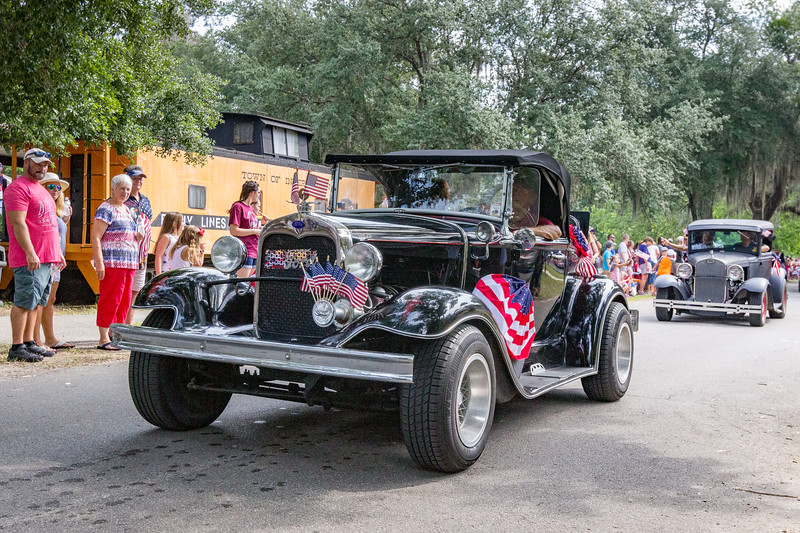 Some antique cars drive in the Independence Day parade through the streets of Interlachen. Fran Ruchalski/Palatka Daily News