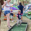 Three-year-old Finley McCall celebrates with Riley McCall after he teed off at miniature golf at the Interlachen Independence Day Celebration. Fran Ruchalski/Palatka Daily News