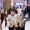 Record-Eagle/Keith King<br /> Mileage Club walkers travel through the hallways Tuesday, March 1, 2011 at Interlochen Elementary School.  Each lap taken in the school, a quarter mile, is marked off on an individual's Mileage Club card. Since winter of 2007 the group has walked the equivalent of the Earth's circumference, approximately 24,900 miles. Destinations are chosen for the walking program and the distance from the chosen location (this year it's Nome, Alaska) and Interlochen Community School is the Mileage Club's goal for distance walked in the school.