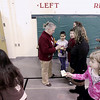 Record-Eagle/Keith King<br /> Colleen Gibbons, of Traverse City Area Public Schools and Interlochen Community Schools, marks Mileage Club cards Tuesday, March 1, 2011 at Interlochen Elementary School. Each lap taken in the school, a quarter mile, is marked off on an individual's Mileage Club card. Since winter of 2007 the group has walked the equivalent of the Earth's circumference, approximately 24,900 miles. Destinations are chosen for the walking program and the distance from the chosen location (this year it's Nome, Alaska) and Interlochen Community School is the Mileage Club's goal for distance walked in the school.