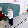 Record-Eagle/Keith King<br /> Colleen Gibbons of Traverse City Area Public Schools and Interlochen Community School, marks the Mileage Club card of Fred Brunas, of Interlochen, Tuesday, March 1, 2011 at Interlochen Elementary School. Each lap taken in the school, a quarter mile, is marked off on an individual's Mileage Club card. Since winter of 2007 the group has walked the equivalent of the Earth's circumference, approximately 24,900 miles. Destinations are chosen for the walking program and the distance from the chosen location (this year it's Nome, Alaska) and Interlochen Community School is the Mileage Club's goal for distance walked in the school.