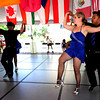 """Jenny Martin dances with her husband, Carlos Martin, both of Erie. The dance is part of a cuban style salsa called """"Rueda de Casino"""" as part of the Los Casineros salsa group at the International Festival on Pearl St. Mall Saturday afternoon.  Rachel Woolf/ For the Camera"""