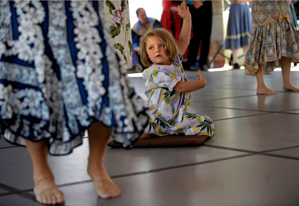Reese Furman, 4 of Boulder hula dances among the rest of the hula group, Keaka O Kalani at the International Festival on Pearl St. Mall Saturday afternoon.  Rachel Woolf/ For the Camera