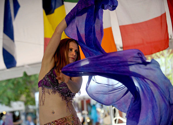 Hillery Burman, of Boulder, belly dances by the name Habina at the International Festival on Pearl St. Mall Saturday afternoon.  Rachel Woolf/ For the Camera