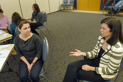 Kaitlyn Pfau of Naperville works on answering interview questions during the Interview Savvy pilot program at the Downers Grove Park District run by Professional Development members of Trilaureate including Allison Heverin Thursday Jan. 3 2013. Erica Benson—ebenson@shawmedia.com