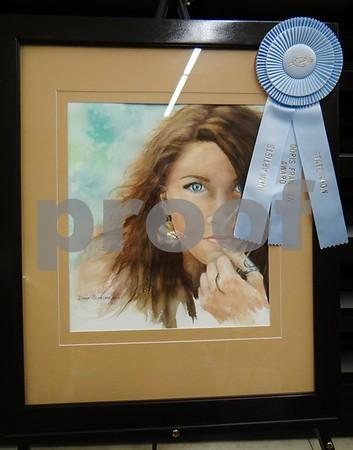 "Donna Jelmeland is the artist of her watercolor painting ""Ellie"". Awarded the Doris Frandsen award."
