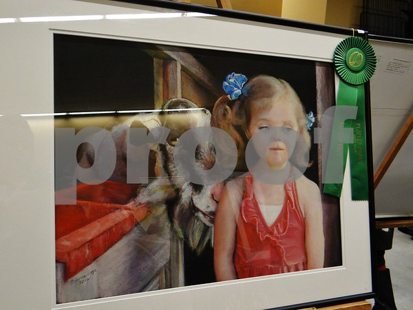 """Diane Liepa the artist of """"Say Goat Cheese"""", awarded People's Choice Award."""