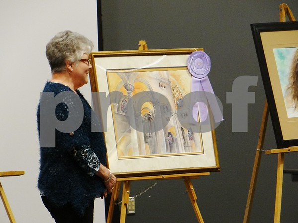 "Joan Kafer Kerns with her painting ""St. Anne de Beaupre"". Awarded with the Richard Heggen Award."