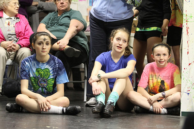 Dancers wait their turn to practice a routine on Ash Wednesday.