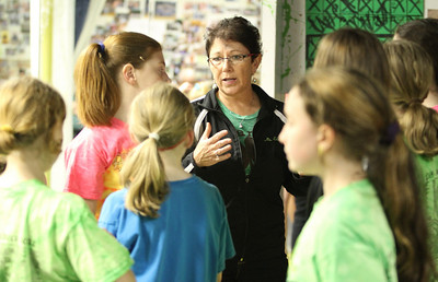 Eileen Mulligan Evans, center, director of The Mulligan School of Irish Dance, provides instructions to some of her dancers.