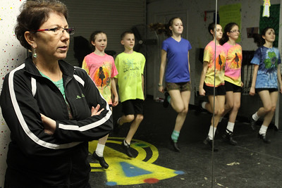 Eileen Mulligan Evans, left, owner and director of The Mulligan School of Irish Dance, started her school in 1974. Here she watches her championship class practice their treble jigs. The dancers include (l-r) Tricia McLeer, Matthew Beilak, Tary Prestwich, Maddy Iassogna, Catherine Vaughn and Katherine Morley.