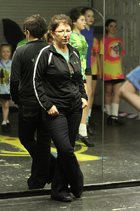 Eileen Mulligan Evans, center, director of The Mulligan School of Irish Dance, observes the dancers.