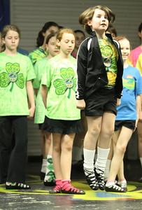 Eight-year-old Abby Eslinger (airborne) practices a soft shoe dance known as a reel with fellow dancers from The Mulligan School of Irish Dance, Marietta. Waiting their turn immediately behind her are (l-r) Kaitlyn Lane, Annie Gero and Sabrina Hampton.