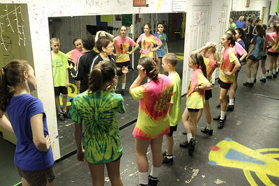 Eileen Mulligan Evans, center, director of The Mulligan School of Irish Dance, works with her championship class.