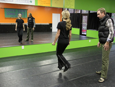 Eighteen-year-old Catie Foley trains under the direction of Karl Drake, right, at The Drake School of Irish Dance studio in Norcross. Foley is a world championship level Irish dancer who is currently ranked ninth in the world. She has been dancing for 13 years.