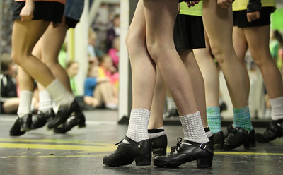 "Wearing their heavy dancing shoes, dancers from The Mulligan School of Irish Dance, Marietta, practice a dance technique known as a ""treble reel"" for some upcoming performances."