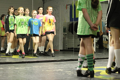 (Front row, l-r) Annie Gero, Sabrina Hampton and Caroline Sigman perform some Irish step dance drills before a mirror inside The Mulligan School of Irish Dance studio, Marietta.