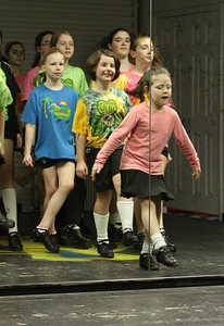 Advanced beginner dancer Erin Johnson, 6, performs a warming up exercise at the Mulligan School of Irish Dance, Marietta. Waiting their turn immediately behind her are (clockwise from center) Abby Eslinger, Sabrina Hampton, Kaitlyn Lane, Maeve Gawryszewski and Caroline Sigman.