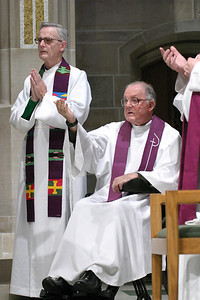 Father John Kieran, standing, pastor of St. Pius X Church, Conyers, and his brother Father Richard attend the annual St. Patrick Day Mass together. The Kieran brothers are native of Ardee (County Louth), Ireland. Father Richard, who celebrates his 45th anniversary as a priest this June, first served at Immaculate Heart of Mary Church when he came to Atlanta in 1965. Father John, a priest for close to 43 years, arrived in 1967 for his first assignment at St. Jude the Apostle Church.