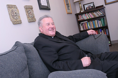Sitting in his Atlanta office, Msgr. James Fennessy, pastor of St. Jude the Apostle Church, reflects on his ordination to the priesthood in Ireland's Newcastle, County Tipperary, nearly 42 years ago. Msgr. Fennessy came to Atlanta August 3, 1968 and his first assignment was at Holy Cross Church, Atlanta.