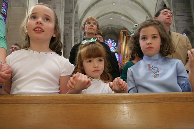 (L-r) Alanna Filberg, 7, Penny Czabala, 5, and Maggie Braswell, 7, join hands during the Our Father. All three girls dance with the King O'Sullivan School of Irish Dance, Marietta.   (Page 27, April 1, 2010 issue)