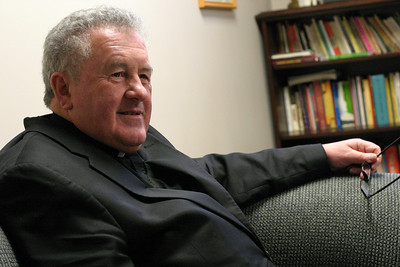 Sitting in his Atlanta office, Msgr. James Fennessy, pastor of St. Jude the Apostle Church, reflects on his ordination to the priesthood in Ireland's Newcastle, County Tipperary, nearly 42 years ago. Msgr. Fennessy came to Atlanta August 3, 1968 and his first assignment was at Holy Cross Church, Atlanta.  (Page 1, March 18, 2010 issue)