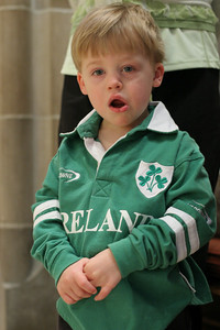 Two-year-old Ryan Johnson is appropriately dressed for St. Patrick's Day as he listens to the music of the Gospel acclamation during the March 17 Mass.  (Page 27, April 1, 2010 issue)