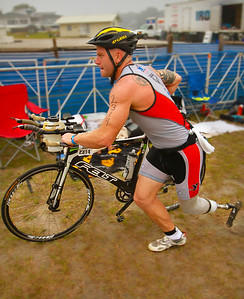 Jeff Nolan dashes to begin the cycle portion of the Ironman Augusta 70.3