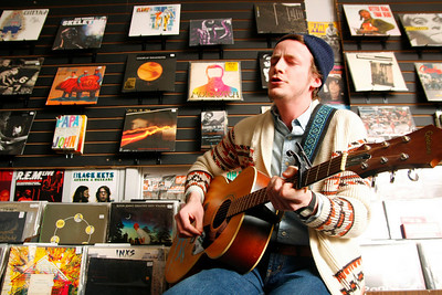 American studies 2008 graduate Ryan Waters sings during his band Irwin Vega's concert in the Record Lounge. The Record Lounge is a relatively new store in East Lansing; it opened on Jan. 2, 2008.