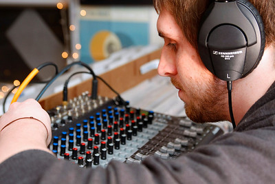 Professional writing junior Hodge Heckaman works the sound board at the Record Lounge. Heckaman works at the Record Lounge and helps book shows like the Irwin Vega unplugged concert.