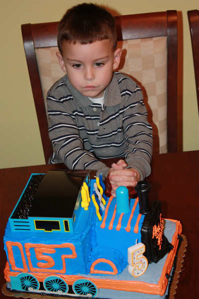 Isaac psyching himself up to blow out the candles