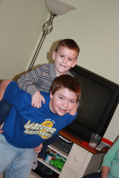 Robert gives the birthday boy a piggy-back ride