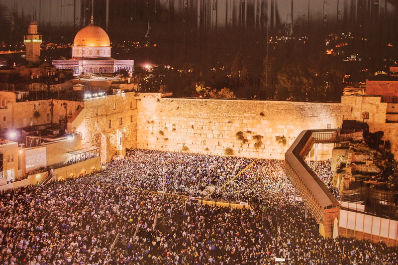 "An image at the Western Wall taken by ""unknown photographer"" at night capturing the thousands next to the Western Wall for a Jewish High Holy Day."