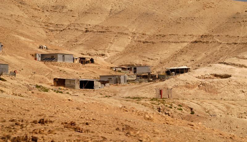 Makeshift homes can be seen at the base of many hills in the area.