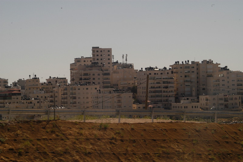 Homes with Black water tanks on top are Arabic residents.  Homes with white water tanks are Jewish residents.