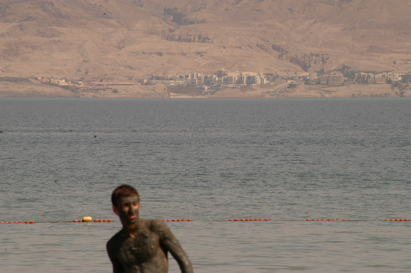 """Mud Man"" - many people put the mud from the dead sea on like lotion for smoother healthier skin.  Jordan can be seen on the other side of the Sea."