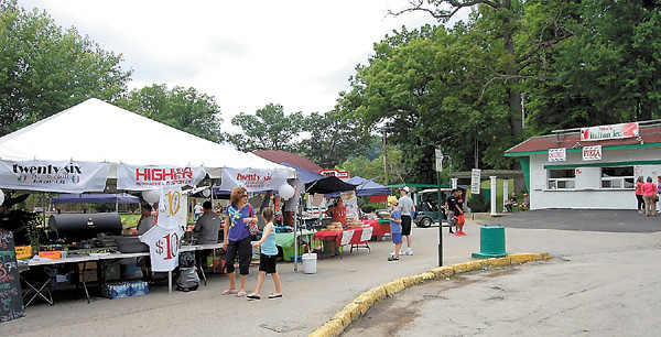 Visitors to the Italian Festival check out some of the vendor tents.<br /> — Sam Luptak Jr.