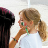 Ryan Greening, 9, of New Castle gets an Italian flag painted on her face.<br /> — Sam Luptak Jr.