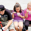 Enjoying their Italian ices are, from left, Ryan Westlund, 12; Romy Westlund, 7;  and their cousin, Karen Patterson, 12.<br /> — Sam Luptak Jr.