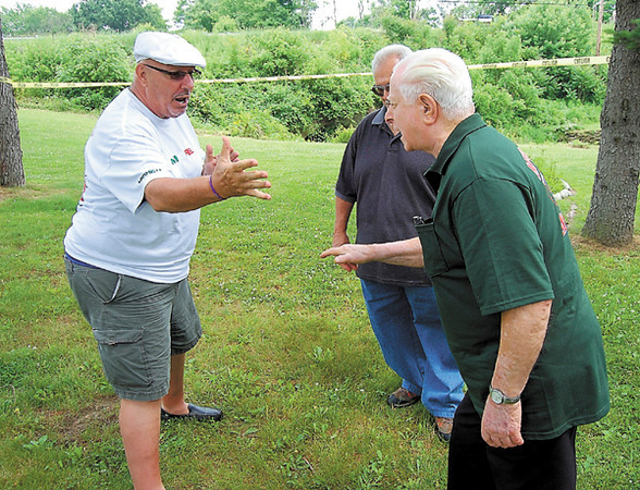 Jim Hiler faces off with 'Uncle John' Tomei in some practice rounds prior to the start of the morra tournament that took place during the weekend Italian Festival at Cascade Park. — Sam Luptak Jr.
