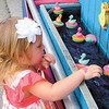 Riley Rickel, 2, of New Castle makes her choice at the duck pond game.<br /> — Sam Luptak Jr.