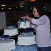 Connie putting last minute touches on the cake.