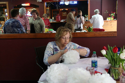 Brenda Parker Hardee making pompoms.