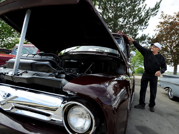 "Chuck Ciancio dusts off his 1956 Ford F100 pickup.<br /> The 10th annual JDBR Streetrodders Car Show was held at Buenos Tiempos Restaurant in Broomfield on Sunday. For more photos of the show, go to  <a href=""http://www.broomfieldenterprise.com"">http://www.broomfieldenterprise.com</a> or  <a href=""http://www.dailycamera.com"">http://www.dailycamera.com</a>.<br /> Cliff Grassmick / May 6, 2012"