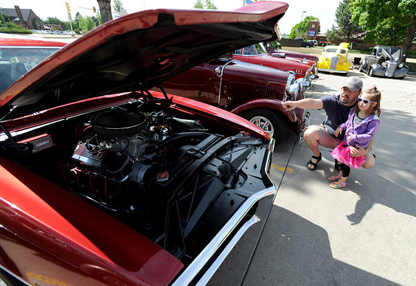 "Juan Evans points out something to his daughter, Reese, 3, about this 1967 Pontiac Firebird.<br /> The 10th annual JDBR Streetrodders Car Show was held at Buenos Tiempos Restaurant in Broomfield on Sunday. For more photos of the show, go to  <a href=""http://www.broomfieldenterprise.com"">http://www.broomfieldenterprise.com</a> or  <a href=""http://www.dailycamera.com"">http://www.dailycamera.com</a>.<br /> Cliff Grassmick / May 6, 2012"