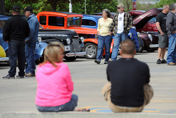 "Kathy and Jim Habenicht, center, walk along the row of classic cars at the show on Sunday.<br /> The 10th annual JDBR Streetrodders Car Show was held at Buenos Tiempos Restaurant in Broomfield on Sunday. For more photos of the show, go to  <a href=""http://www.broomfieldenterprise.com"">http://www.broomfieldenterprise.com</a> or  <a href=""http://www.dailycamera.com"">http://www.dailycamera.com</a>.<br /> Cliff Grassmick / May 6, 2012"