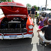 "Reese Evans, 3, runs to hug her grandfather, Dennis Smith, as dad, Juan Evans watches.<br /> The 10th annual JDBR Streetrodders Car Show was held at Buenos Tiempos Restaurant in Broomfield on Sunday. For more photos of the show, go to  <a href=""http://www.broomfieldenterprise.com"">http://www.broomfieldenterprise.com</a> or  <a href=""http://www.dailycamera.com"">http://www.dailycamera.com</a>.<br /> Cliff Grassmick / May 6, 2012"