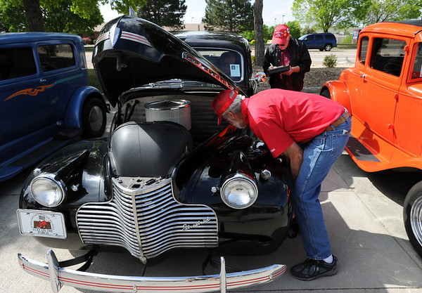 """Andy Anderson, foreground, and Pat Shaw, do a safety inspection on this 1940 Chevy truck.<br /> The 10th annual JDBR Streetrodders Car Show was held at Buenos Tiempos Restaurant in Broomfield on Sunday. For more photos of the show, go to  <a href=""""http://www.broomfieldenterprise.com"""">http://www.broomfieldenterprise.com</a> or  <a href=""""http://www.dailycamera.com"""">http://www.dailycamera.com</a>.<br /> Cliff Grassmick / May 6, 2012"""