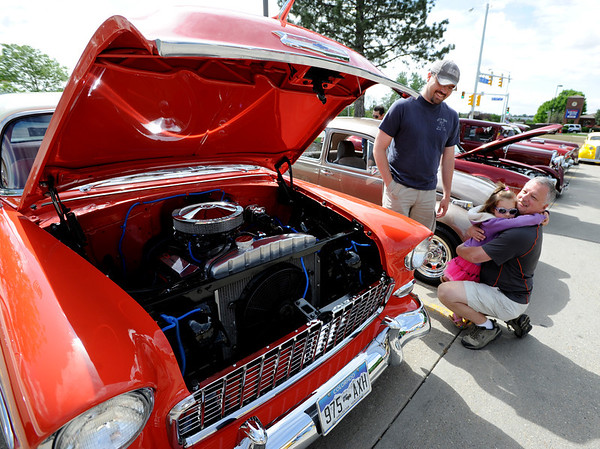 """Reese Evans, 3,  hugs her grandfather, Dennis Smith, as dad, Juan Evans watches.<br /> The 10th annual JDBR Streetrodders Car Show was held at Buenos Tiempos Restaurant in Broomfield on Sunday. For more photos of the show, go to  <a href=""""http://www.broomfieldenterprise.com"""">http://www.broomfieldenterprise.com</a> or  <a href=""""http://www.dailycamera.com"""">http://www.dailycamera.com</a>.<br /> Cliff Grassmick / May 6, 2012"""